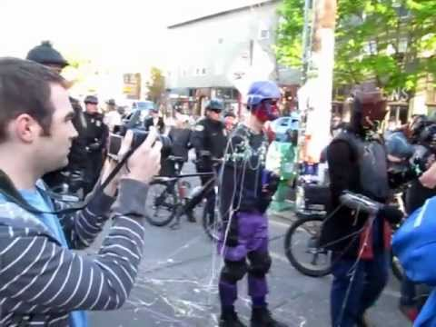 Phoenix Jones' Rain City Superhero Movement gets silly-stringed by Protesters on May Day