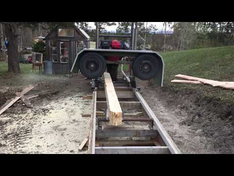 50$ homemade bandsawmill ripping a pinetree in sweden