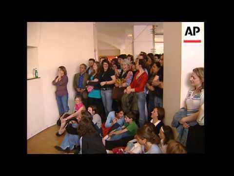 Expatriates watch exit polls, react