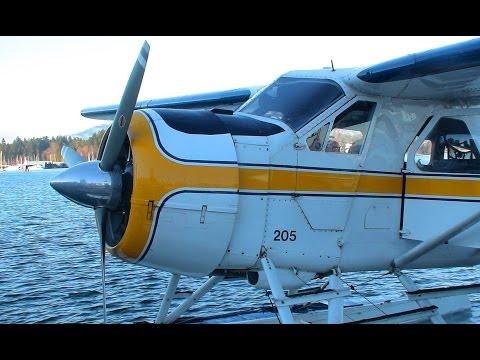 De Havilland float-plane flight over Vancouver on a bright sunny day.