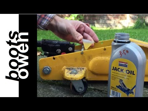 filling a trolley jack with oil