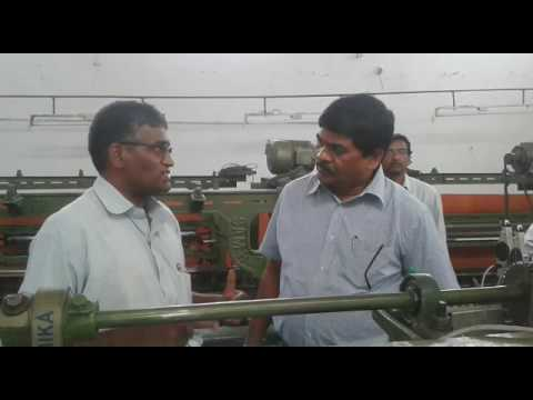 Government officials inspection of loom