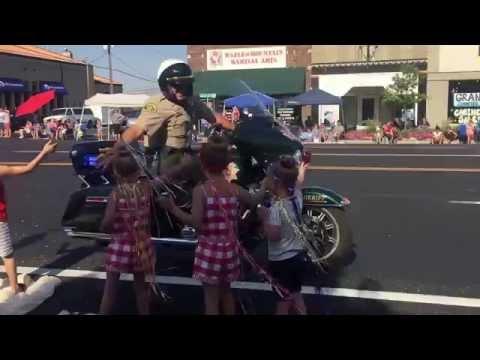 Cops at Parade High-fives!
