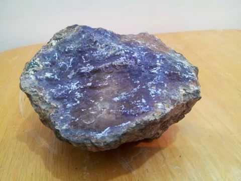 kimberlite with rough diamonds and a range of gem stones v