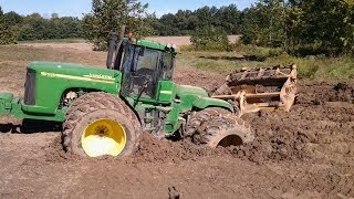Moving the dirt with our new 750J Deere and 9520 Scraper Tractor and Pans