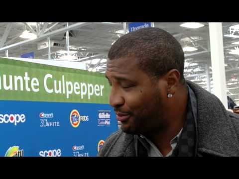 Daunte Culpepper answers media questions at Grand Opening of Moorhead Sam