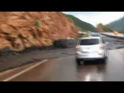 Car swept away by flash floods in Colorado past stranded vehicles