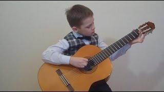Ребенок играет на гитаре. 1-й класс музыкальной школы. | Child plays guitar