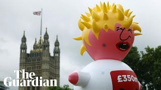 Boris blimp lifts off outside parliament in anti-Brexit march