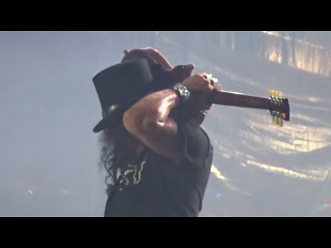 Slash playing guitar behind head – Guns N' Roses