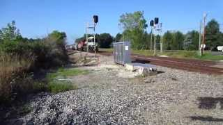 NS SD70ACe, CN SD60F quickly hauling a covered hopper train
