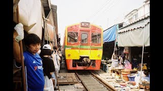 RAILWAY MARKET IN MAEKLONG- TRAIN RUNS THROUGH. SAMUT SONGKHRAM, THAILAND