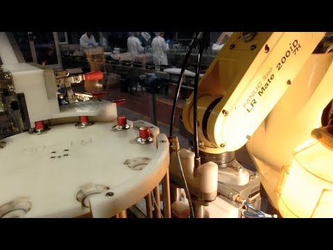Robotic System for Picking, Placing & Crimping Spray Pumps On Cosmetics Bottles - Farason Corp.