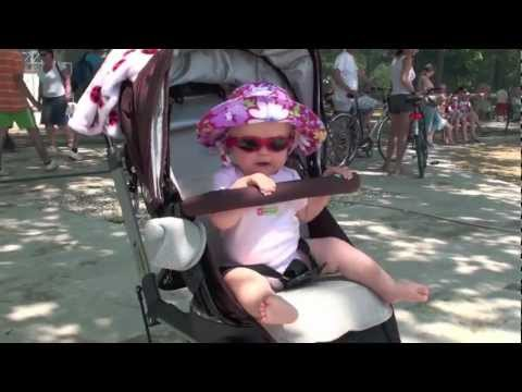 Adorable Baby Shakes Her Bootie To Music Sitting In Stroller