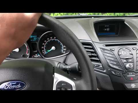 FORD FIESTA- Setting and releasing the parking brake