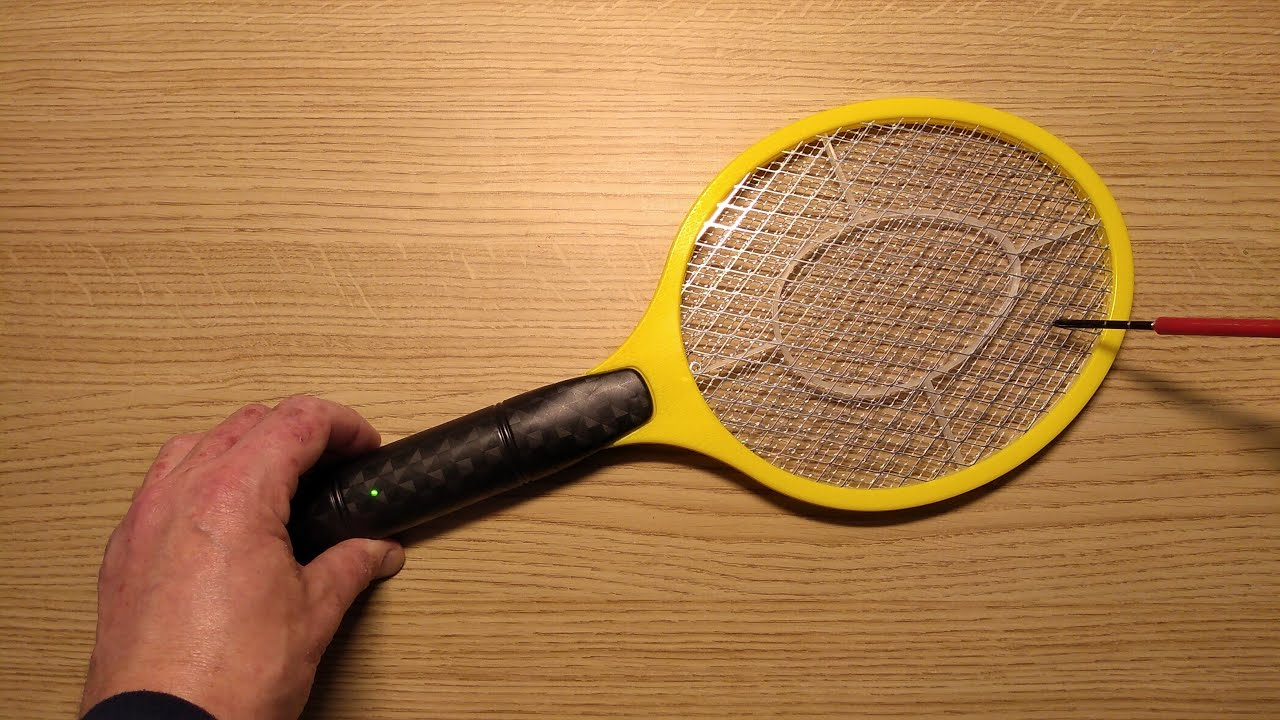 Inside Poundland's electric fly zapper bat  (with schematic)
