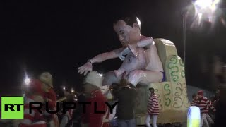 Naked Cameron with pig effigy paraded & burnt down in UK fest