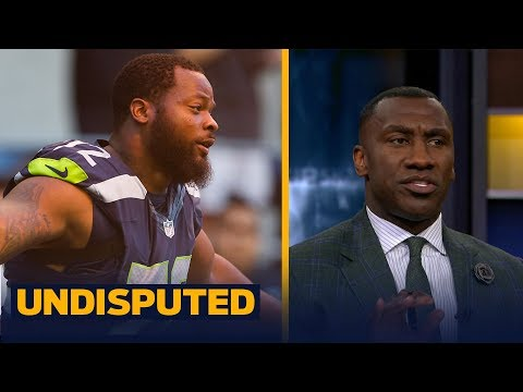 Marshawn Lynch, Michael Bennett sit on bench for national anthem - Shannon responds | UNDISPUTED