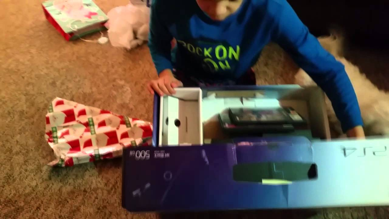 Little brother opens a PS4 box to find a PS2 inside for Christmas ...