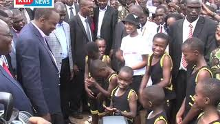 President Uhuru joins Kisii pupils in performing a rap song