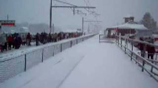 MUST SEE!! Acela with tons and tons of horn flying through the snow