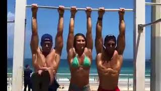A pretty girl beating 2 guys in bar push ups