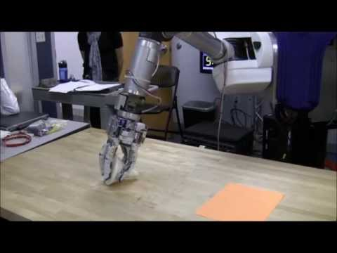 Design and Testing of a Selectively Compliant Underactuated Hand