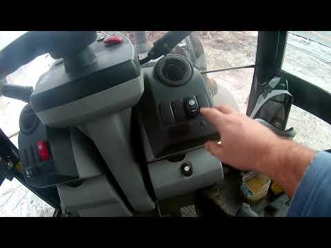 CAT 428E обзор кабины