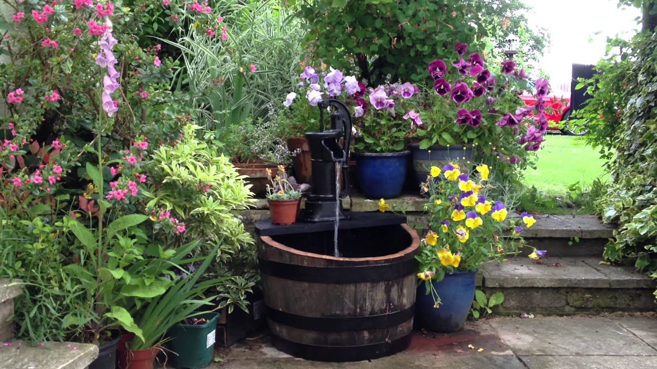Hand pump water feature english country garden youtube for Garden water pump