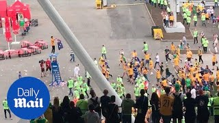 Celebrating Australian fans break through security after draw