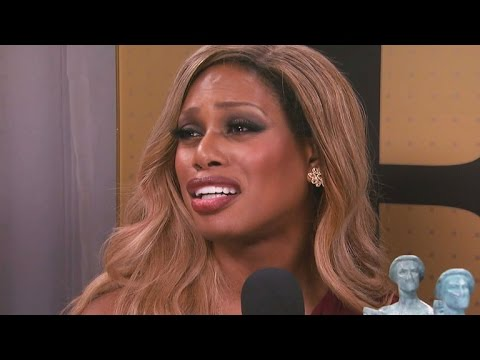 EXCLUSIVE: Laverne Cox Fights Back Tears As She Recalls Her Journey 'Struggling to Survive'