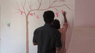 Painting tree on wall