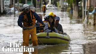Torrential rain has caused heavy flooding and landslides in south-w...