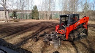 kubota slv90 2 spreading topsoil harley raking a torch lake property