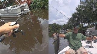 skipping a bait casting reel big bass on senko lure under pontoon boat
