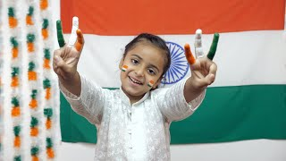 Little Indian girl with her fingers painted with national tri colors - Independence day arts concept