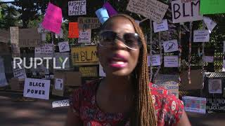 USA: Locals react as anti-riot fencing around White House transformed into memorial wall