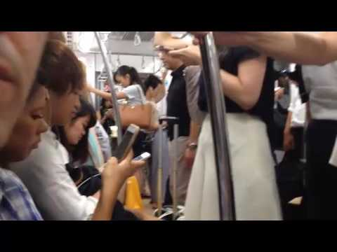Tokyo Tourism: The Tokyo Subway - People Staring at Their Smartphones