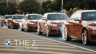 The Epic Driftmob feat. BMW M235i(Is it possible to make a drift-choreography in a rotary traffic? We took some hollywood stunt driver and added the same amount of BMW M235i cars. The result: ..., 2014-07-30T06:53:10.000Z)