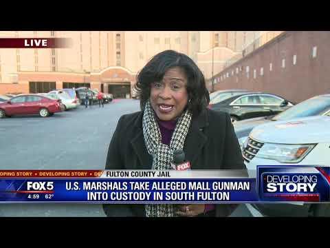 Authorities take alleged mall gunman into custody