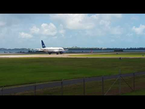 American Airlines Plane landing and JetBlue Plane  taking off at Bermuda Airport