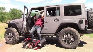 Glide 'n Go Transfer Lift Seat in Lifted Jeep Wrangler Sahara (entering, with wheelchair stowage) ^