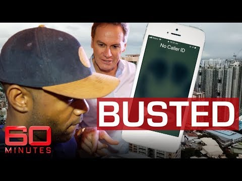 Reporter tracks down scammers in dramatic raid | 60 Minutes Australia