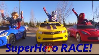 Superheroes Mega Power Wheels Race 3!  5 Ride On Cars! | Gabe and Garrett