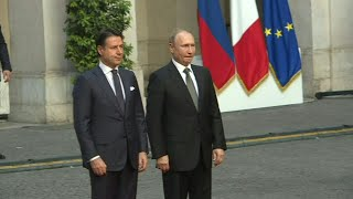 Russian president vladimir putin is welcomed by italian prime minister giuseppe conte in rome. italy's populist government has called for an easing of sancti...