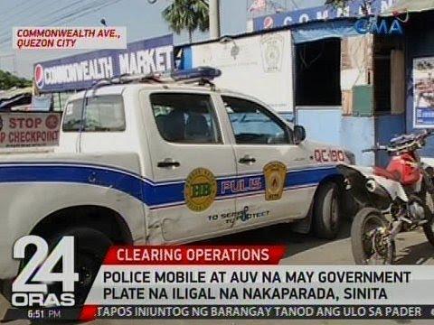24 Oras: Police mobile at AUV na may government plate na iligal na nakaparada, sinita ng MMDA