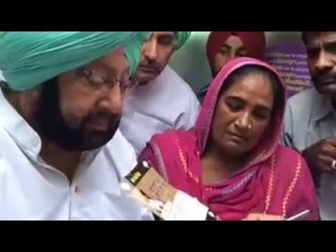 Capt Amarinder Singh filling the forms of Farmers to free from loan