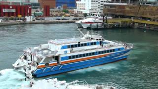 Austal 40 metre high speed passenger catamaran use single waterjet leaves the berth