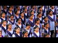 School girls in neat attire at morning assembly in South India