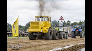 Big trucks hooked to a pulling sled